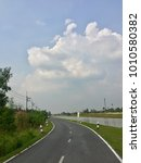 Small photo of Local Road get along Canal in the country. Perspective landscape of lcal road.
