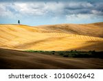 Small photo of Val D' Arbia, Tuscany June 23, 2017. Typical Tuscan landscape with round bales after harvest.