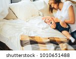 mother and 2 year old daughter... | Shutterstock . vector #1010651488