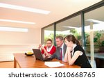 business team look at computer | Shutterstock . vector #1010668765