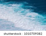 a texture of turquoise wave in... | Shutterstock . vector #1010709382