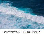 a texture of turquoise wave in... | Shutterstock . vector #1010709415