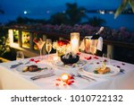 romantic candlelight dinner... | Shutterstock . vector #1010722132
