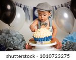 boy birthday cake smash | Shutterstock . vector #1010723275