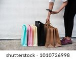 shopping bags of women crazy... | Shutterstock . vector #1010726998