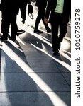 businessman walking quickly on... | Shutterstock . vector #1010759278