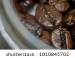 close up of coffee beans in... | Shutterstock . vector #1010845702