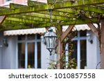 pergola with a light in the... | Shutterstock . vector #1010857558