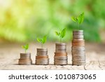 tree growing on coins stack... | Shutterstock . vector #1010873065