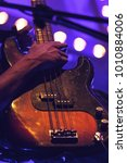 Small photo of Electric bass guitar player, live hard rock music theme