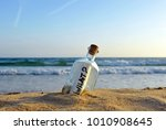 bottle with question inside... | Shutterstock . vector #1010908645