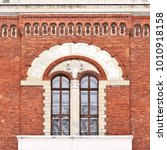 windows of of an old building.    Shutterstock . vector #1010918158