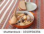 orange pot with stewed rabbit... | Shutterstock . vector #1010936356