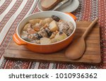 orange pot with stewed rabbit... | Shutterstock . vector #1010936362