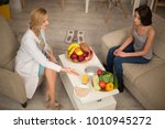 nutritionist giving adice of... | Shutterstock . vector #1010945272