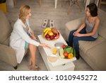 nutritionist giving adice of... | Shutterstock . vector #1010945272
