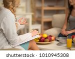 female nutritionist giving... | Shutterstock . vector #1010945308
