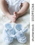 Small photo of baby shoes and baby