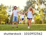 happy family in the park.    Shutterstock . vector #1010952562