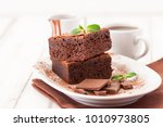 chocolate brownie square pieces ... | Shutterstock . vector #1010973805