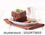 chocolate brownie square pieces ... | Shutterstock . vector #1010973835
