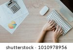 hand on keyboard on office... | Shutterstock . vector #1010978956