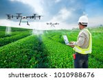 technician farmer use wifi... | Shutterstock . vector #1010988676