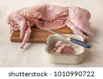 raw rabbit carcass on the... | Shutterstock . vector #1010990722