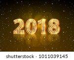 golden 2018 happy new year on... | Shutterstock .eps vector #1011039145
