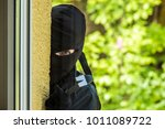 a burglar wants to break into a ... | Shutterstock . vector #1011089722