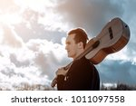 drifter with a guitar | Shutterstock . vector #1011097558