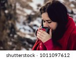 hipster girl drinking coffee on ... | Shutterstock . vector #1011097612
