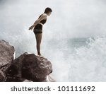 female swimmer on rock above... | Shutterstock . vector #101111692