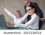 happy corporating businss team... | Shutterstock . vector #1011136516