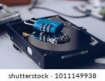 encrypted hard disk. padlock... | Shutterstock . vector #1011149938