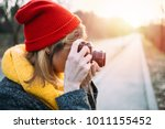 girl photographing with retro...   Shutterstock . vector #1011155452