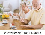 senior man taking medication... | Shutterstock . vector #1011163015