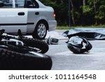motorcycle helmet on the street ... | Shutterstock . vector #1011164548