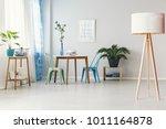 wooden lamp in bright dining... | Shutterstock . vector #1011164878