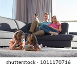 happy young family playing... | Shutterstock . vector #1011170716