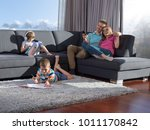 happy young family playing... | Shutterstock . vector #1011170842