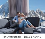 young couple relaxing at  home... | Shutterstock . vector #1011171442