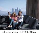 young couple on the sofa... | Shutterstock . vector #1011174076