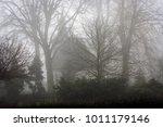 silhouette of a white church... | Shutterstock . vector #1011179146