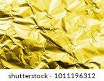 crumpled golden aluminum foil... | Shutterstock . vector #1011196312