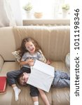 brother and sister reading a... | Shutterstock . vector #1011198346