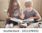 brother and sister reading a... | Shutterstock . vector #1011198352