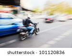 city traffic with a motorbike and cars in motion blur - stock photo