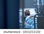 lonely woman suffering from... | Shutterstock . vector #1011211132