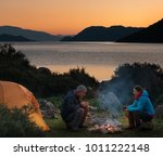 couple camping with campfire... | Shutterstock . vector #1011222148